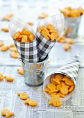 Fish-shaped cheese crackers in paper cones