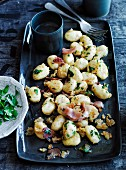 Potato dumplings with crisp breadcrumbs and speck