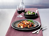 Aubergine bake with salad and wine
