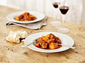 Beef goulash with bread and wine