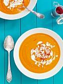 Pumpkin soup with cream, pumpkin seeds and saffron