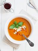 Tomato and pumpkin soup with saffron in a white bowl