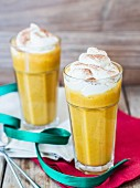 Pumpkin spice smoothies with whipped cream.