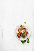 Fried tuna fish with cherry tomatoes and a lime and sour cream sauce
