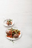 Meatballs with green beans, tomatoes and soya cream
