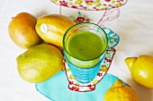 A mango and lemon smoothie with spinach