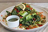 Kale salad with carrots, courgettes and a seaweed dressing