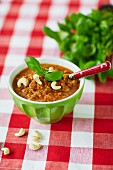 Detox gazpacho made from tomatoes, carrots, peppers and cashew nuts