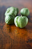 Tomatillos on a wooden surface