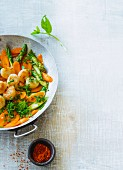 Scallops with fried asparagus and carrots
