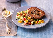 Tuna fish steak on a vegetable and couscous salad