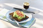 Avocado and canellini bean spread with Italian salami on pumpernickel