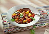 Black bean chilli with potatoes and coriander
