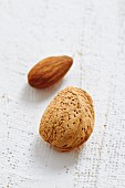 An unshelled almond and an almond
