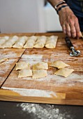 Homemade ravioli on a wooden board