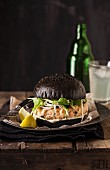 Salmon burger with a black brioche roll