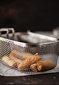 Spring rolls in a frying basket