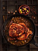 Spicy chicken in an onion sauce with olives