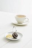 A cup of black tea with lemon