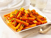 Carrots with butter and chives with a spoon