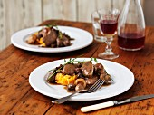 Coq au vin served on butternut squash purée with thyme and chives