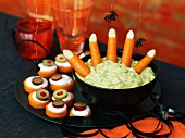 A Halloween dip with carrots and canapes