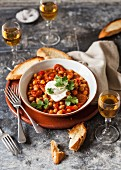 Chickpea stew with chorizo, sour cream and coriander