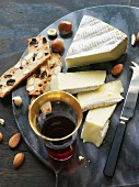 Slices of Brie with crackers on a marble chopping board