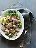 A green salad with poached salmon