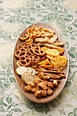 Snacks on an oval wooden plate