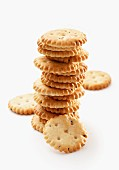 A stack of salted crackers on a white surface