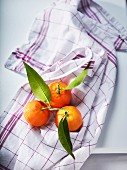Clementines on a tea towel