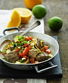 Veal in a citrus fruit sauce with tomatoes, spring onions and avocado