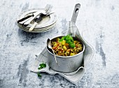 Vegetable stew with pork mince and pasta in a steel pan