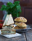 Cucumber sandwiches and wholemeal rolls