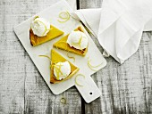 Three pieces of lemon tart with ice cream