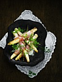 Fried white asparagus wrapped in bacon