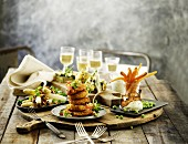 Spring dishes and wine on a rustic wooden table