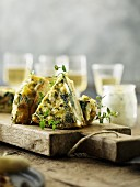 Pieces of a potato and spinach Spanish omelette with oregano