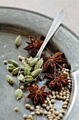 An arrangement of cardamom, star anise and coriander