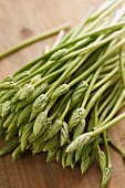 Wild asparagus on a rustic wooden surface