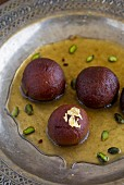 Gulab jamun (fried dough balls in a flavoured sugar syrup, India)