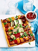 Sausage vegetable roulade tart