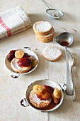 Sponge cakes with plum compote