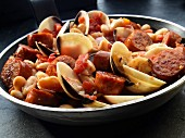 Mussels and sausage with white beans and tomatoes
