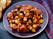 Fried potatoes with sausage, peppers and onions