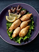 Fried calamari tubes with lemons