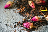 Dried black tea and rooibos with rose buds