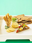 Various crackers with dips
