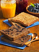Buckwheat and blueberry toast, and oat toast, jam and blueberries
